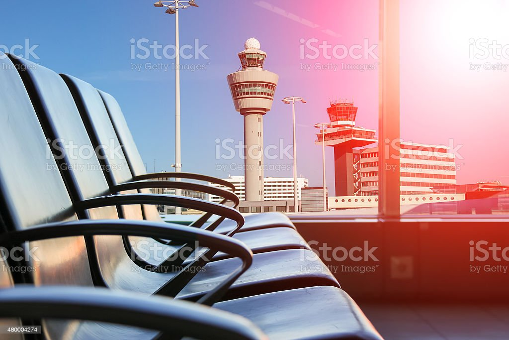 Row of chairs to hall in the airport stock photo