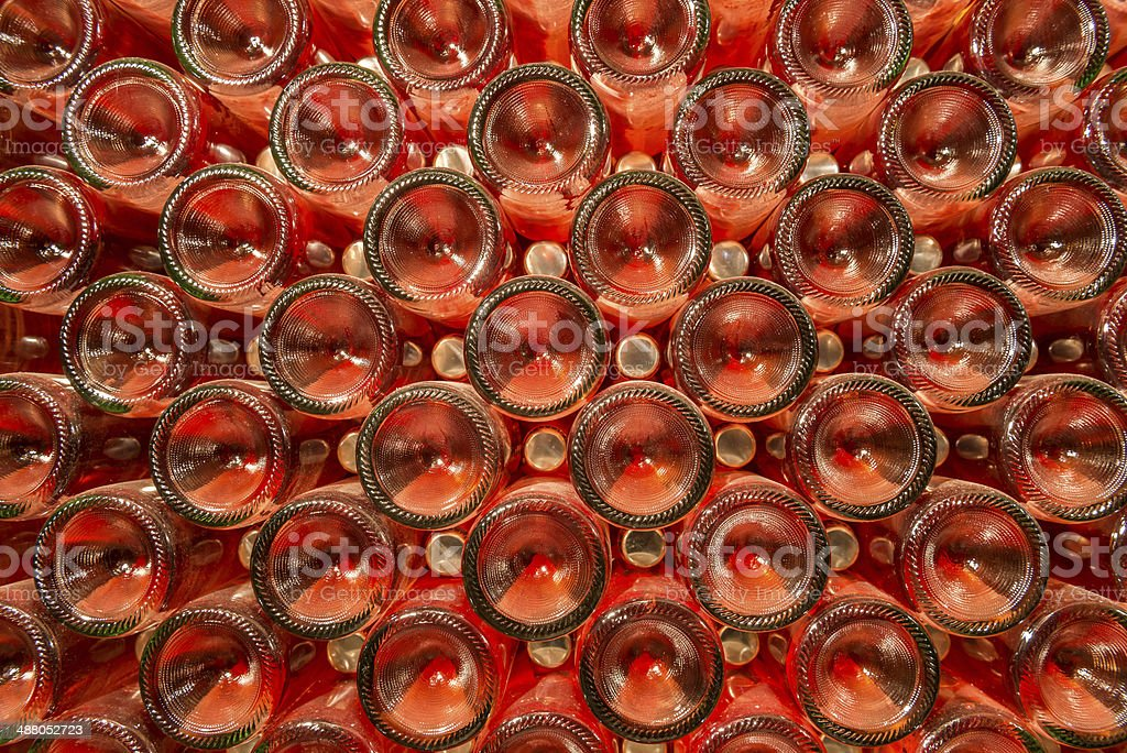 Row of champagne bottles - Wine cellar stock photo