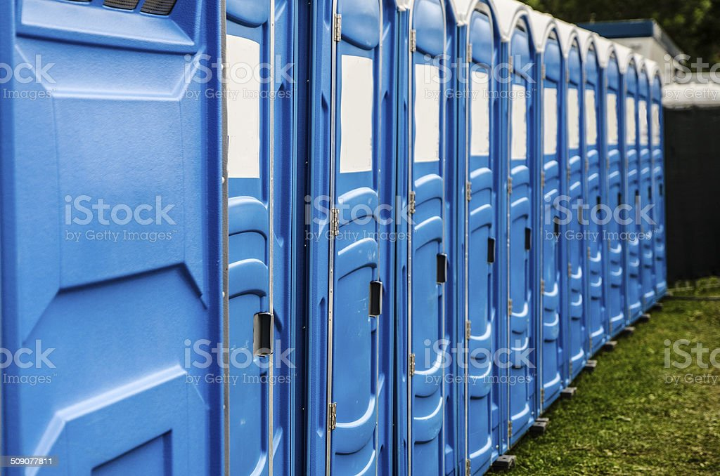 Row of chemical and portable toilets stock photo