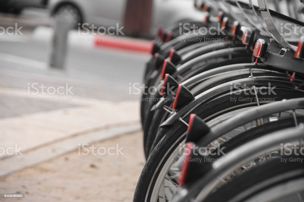 Row of city bikes for rent stock photo