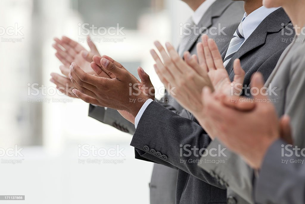 Row of clapping business executives. stock photo