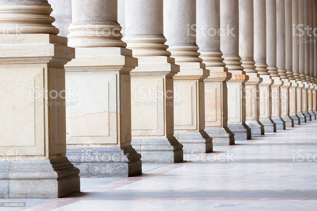 Closeup bases row of marble columns. Symbols of integrity, stability,...