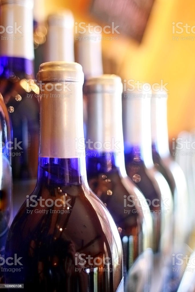Row of Cobalt Blue Wine Bottles - Close Up royalty-free stock photo