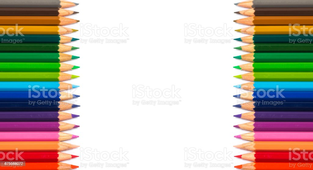 Row of color pencil on white background with copyspace in the middle. stock photo
