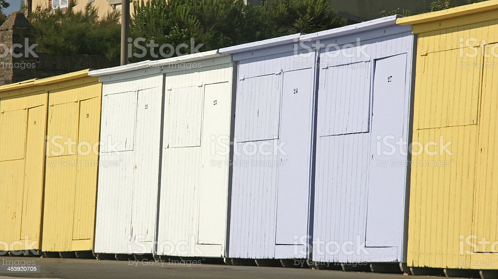 Row of colored beach hut on a french coast, normandy. royalty-free stock photo