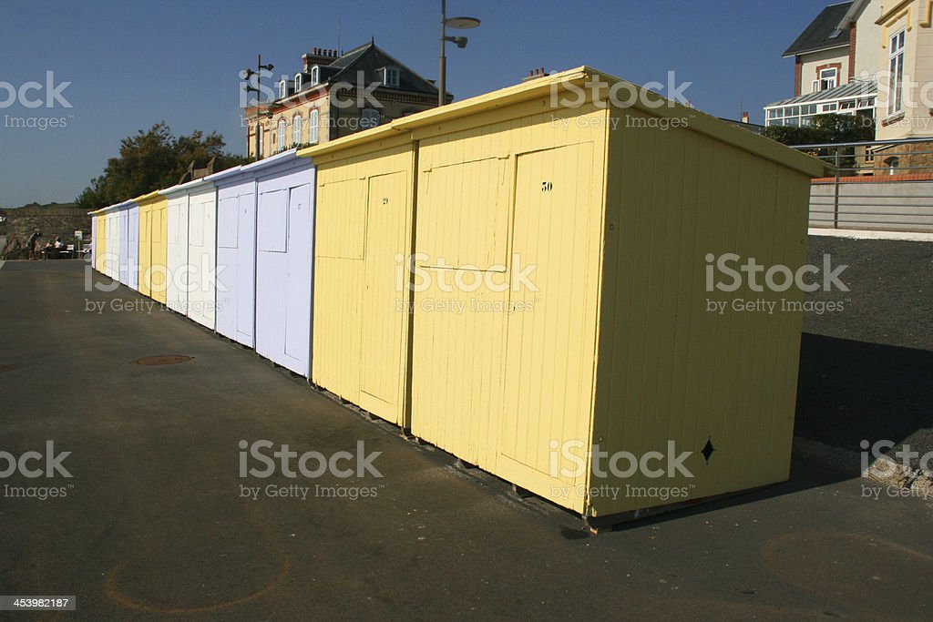 Row of colored beach huts on a French coast, Normandy. royalty-free stock photo