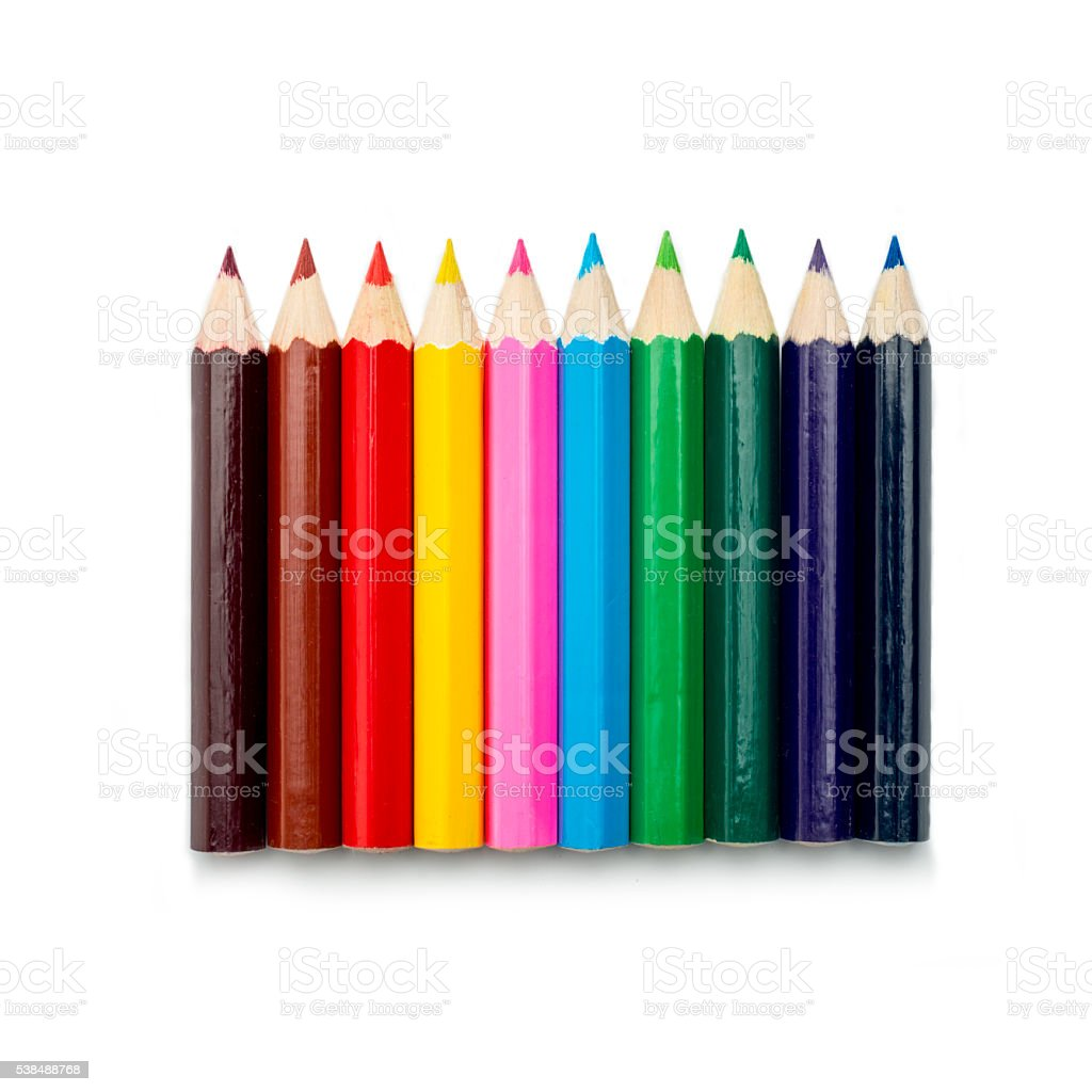 row of colored pencils on white stock photo