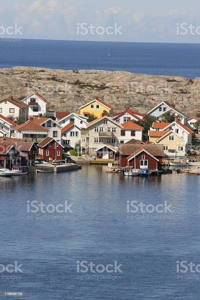 Row of colored swedish coastal houses and motorboats, smogen, sweden royalty-free stock photo