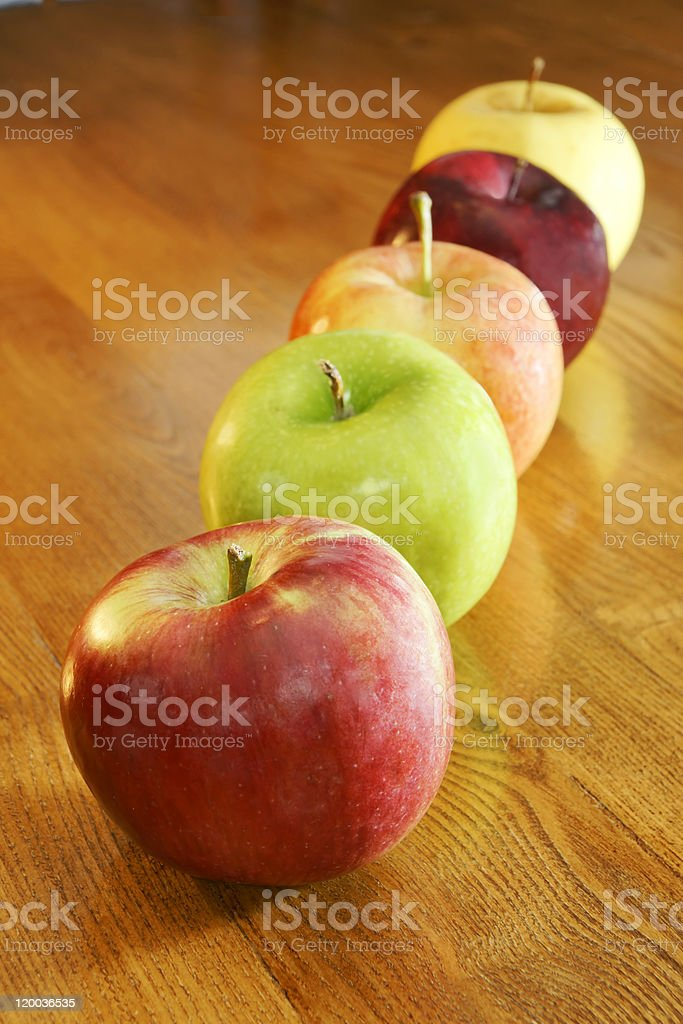 Row of colorful apples stock photo