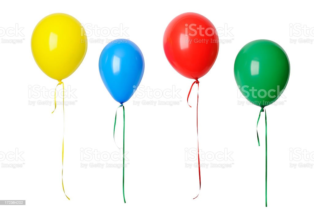 Row of colorful balloons in mid-air against whte background stock photo