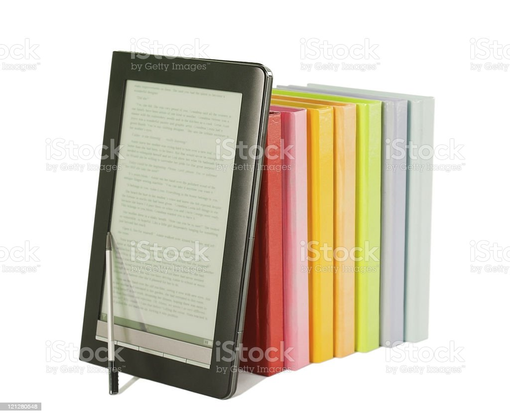 Row of colorful books and electronic book reader on white royalty-free stock photo