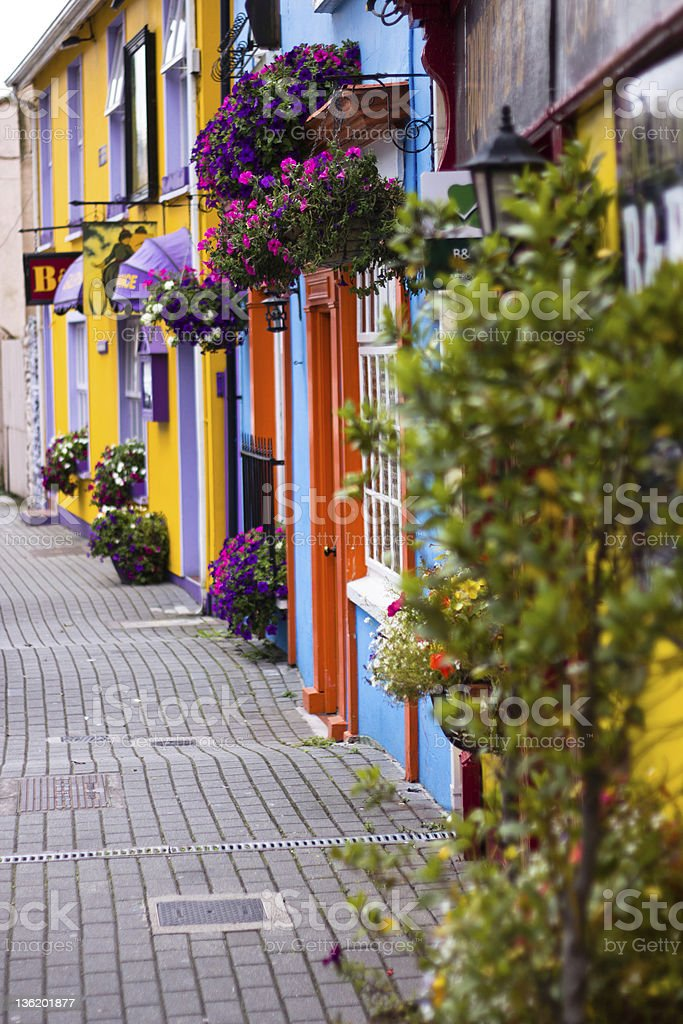 Row of colorful building fronts seen from the street stock photo