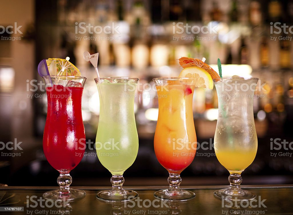 Row of Colorful Cocktail Beverages royalty-free stock photo
