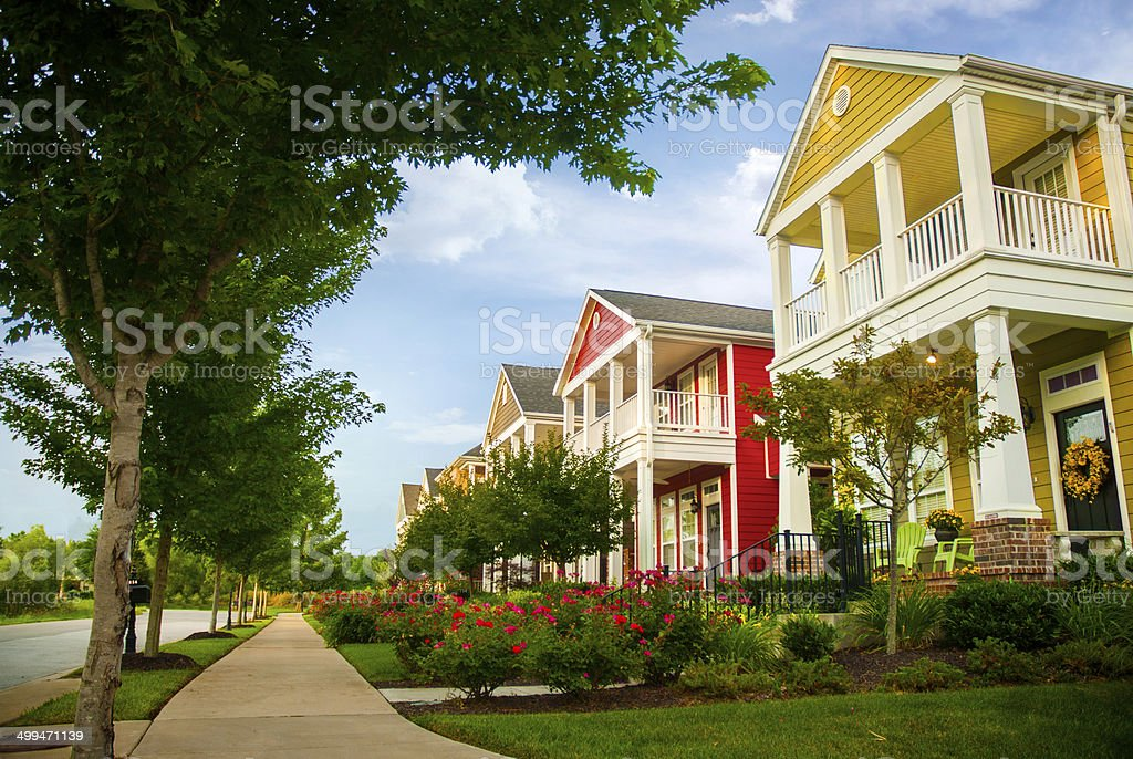 Row of colorful garden homes in suburban area stock photo