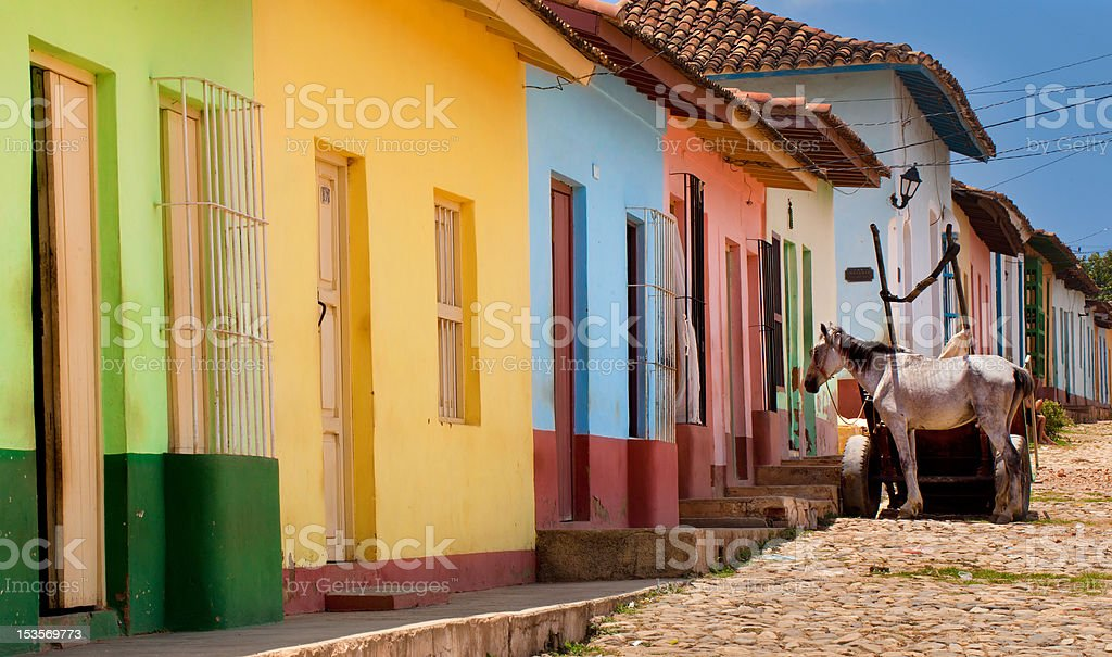 A row of colorful houses in Trinidad, Cuba stock photo