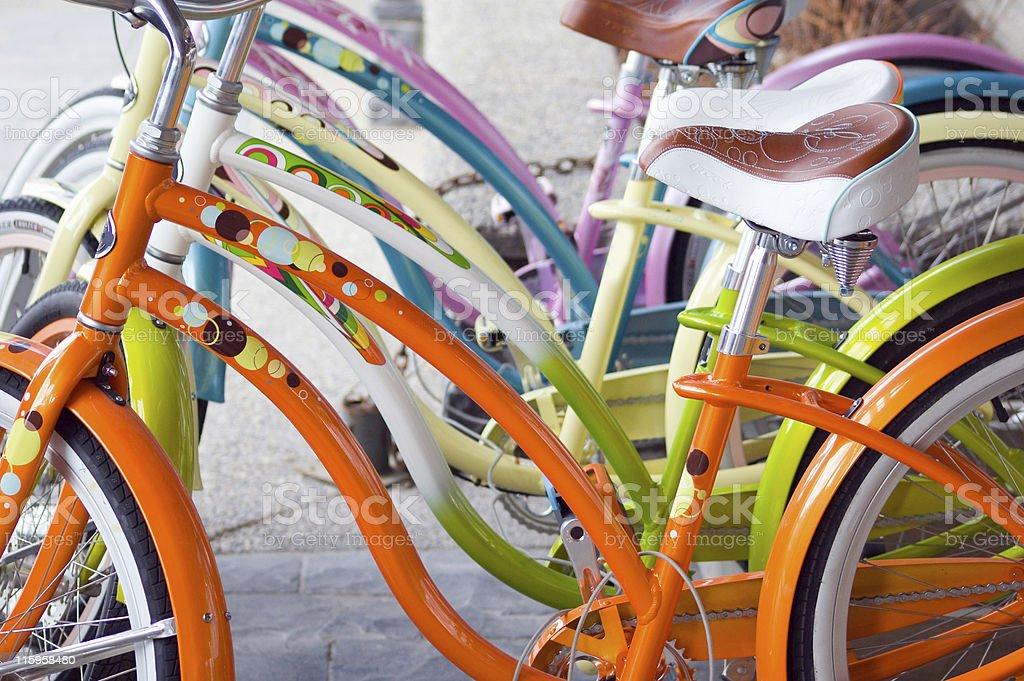 Row of colorful retro replica bikes. stock photo