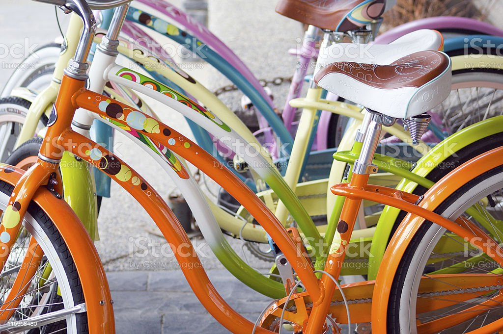 Row of colorful retro replica bikes. stock photo