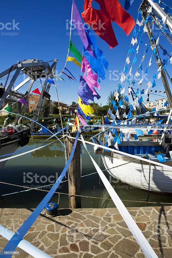 Row of coloured flags against the sky. stock photo