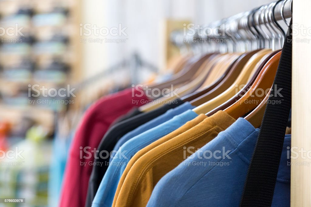 Row of colourful Apparel on Hangers of Retail Shop stock photo