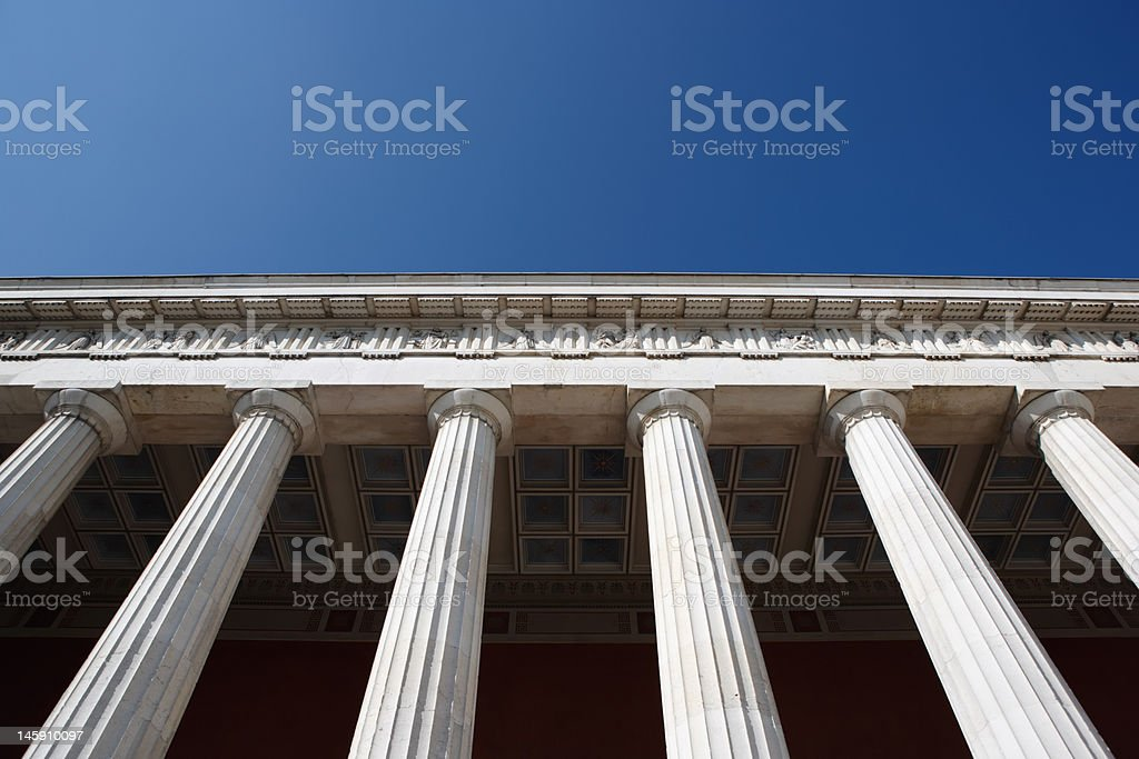 row of columns against blue sky royalty-free stock photo