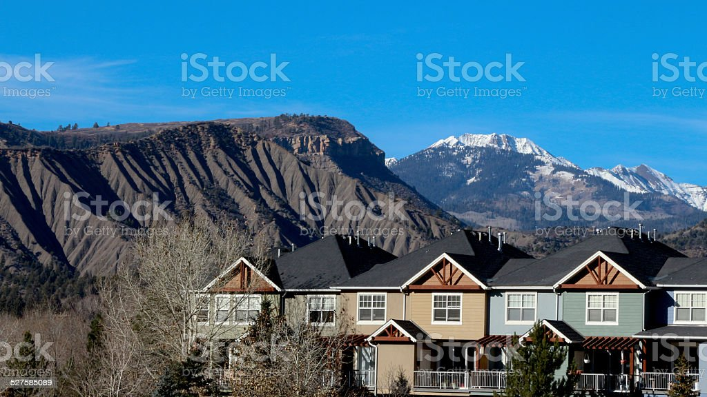 Row of condos with mountains behind in Durango stock photo