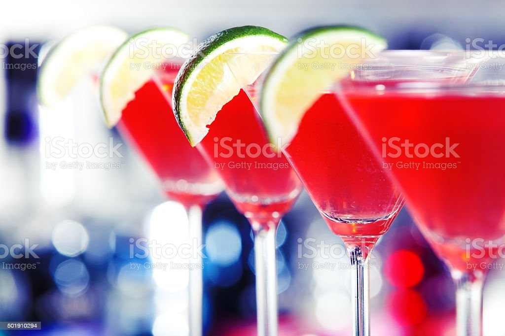Row of Cosmopolitan cocktails stock photo