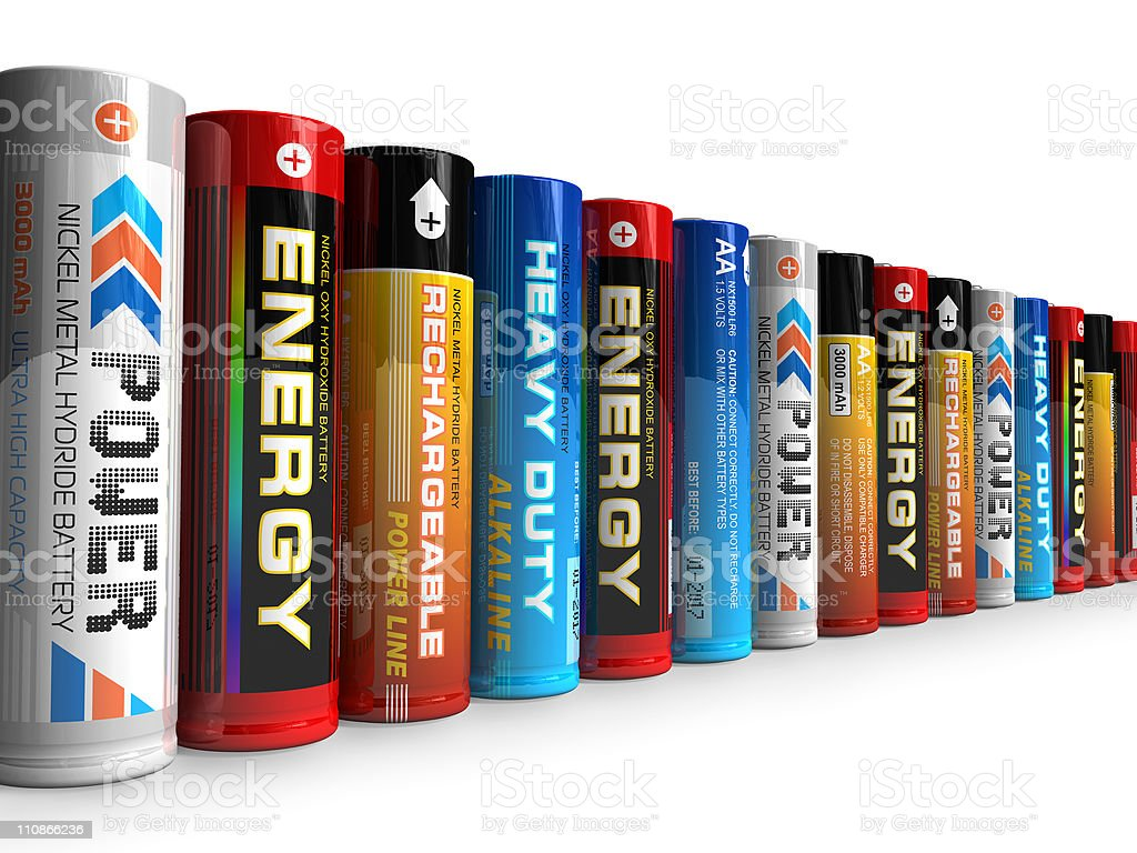 Row of different AA batteries stock photo