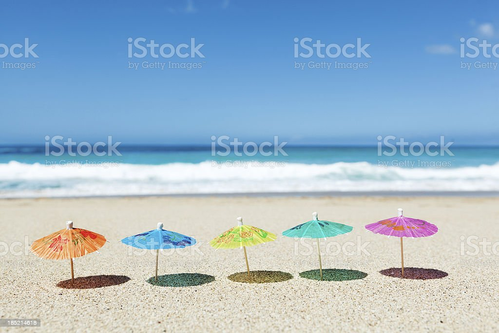 Row of Drink Umbrellas on Tropical Paradise Vacation Beach royalty-free stock photo