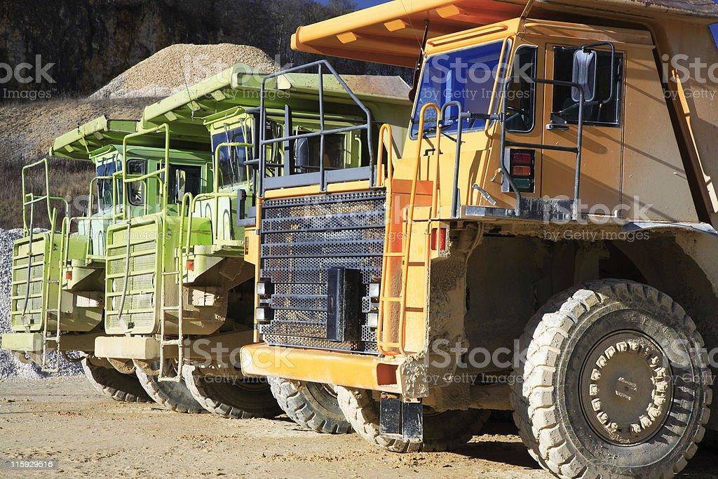 Row of Dump Trucks royalty-free stock photo
