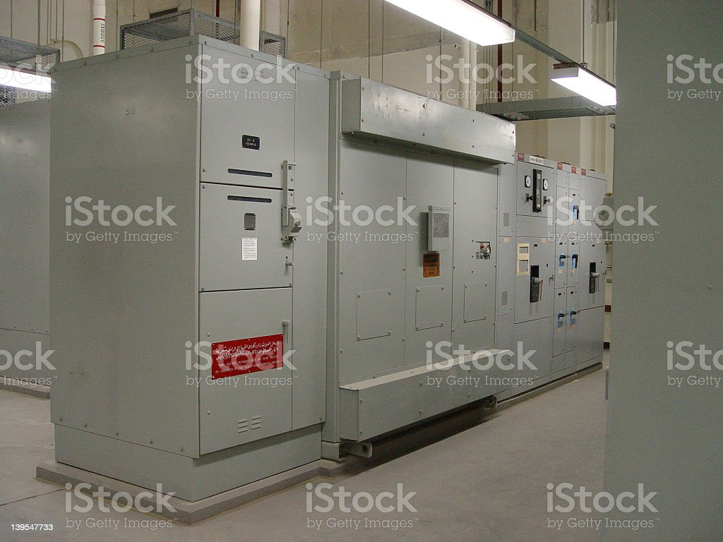 Row of electrical panels in a spacious room stock photo