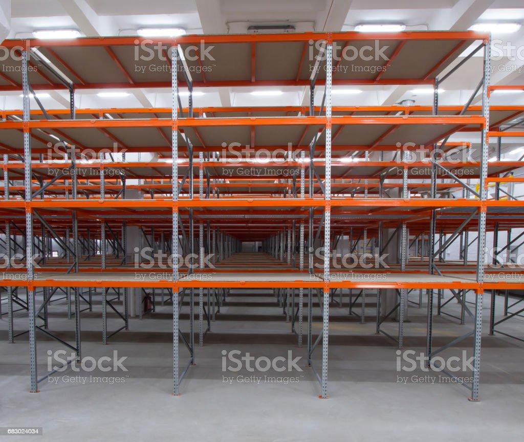 Row of empty shelves. High-rise metal racks. Mezzanine shelves. stock photo