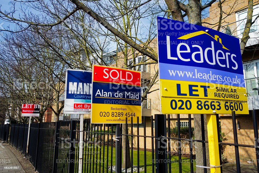 Row of estate agents' signs in Beckenham, Kent stock photo