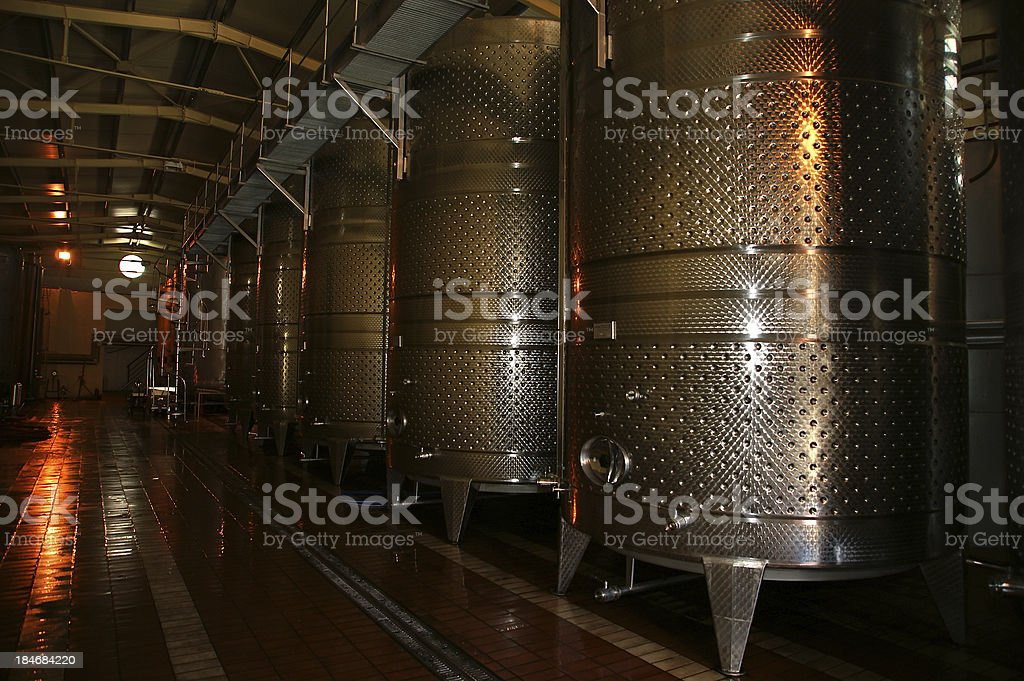 row of fermenters inside a modern winery royalty-free stock photo