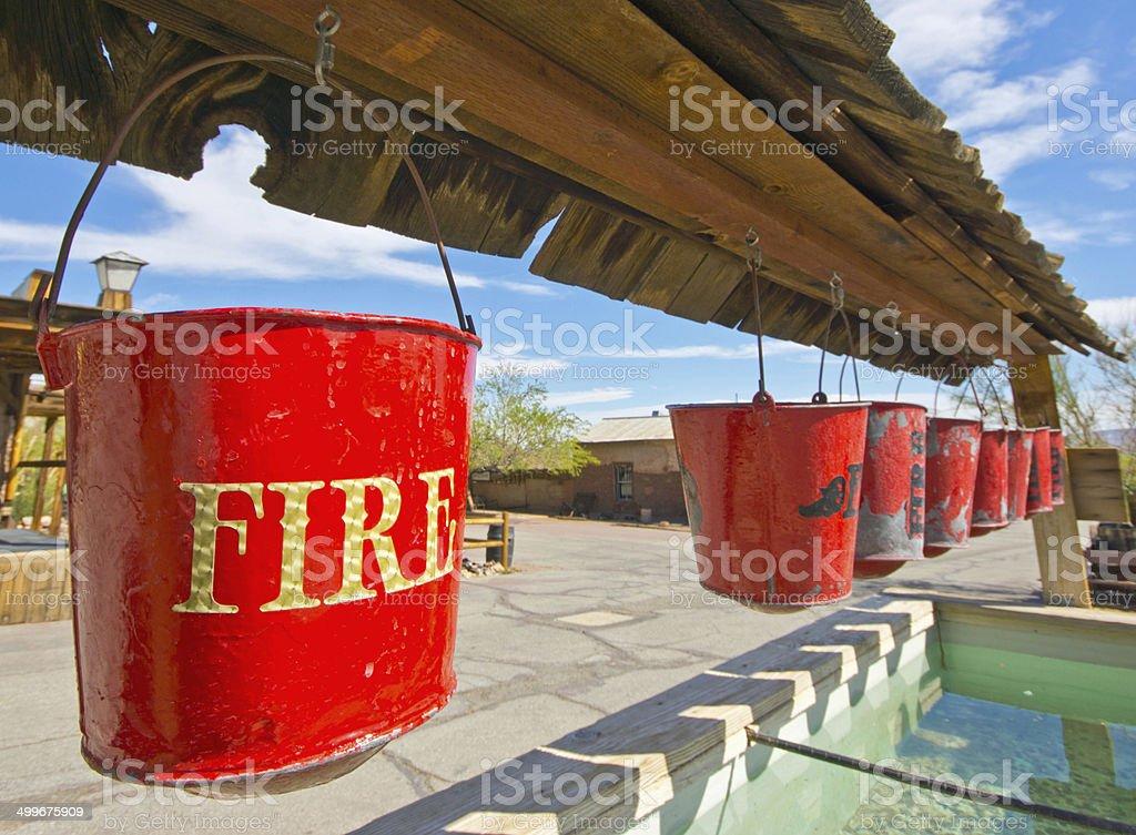 Row of fire buckets royalty-free stock photo