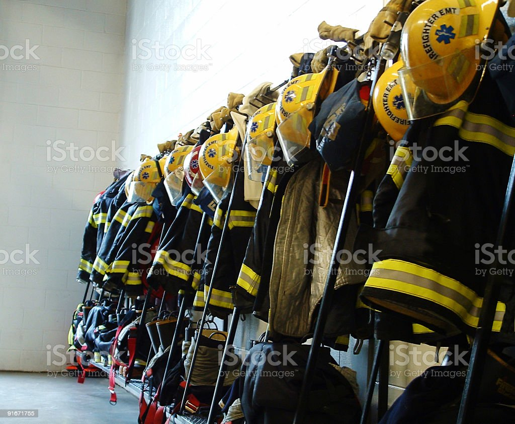 Row of firefighter equipment on rack stock photo