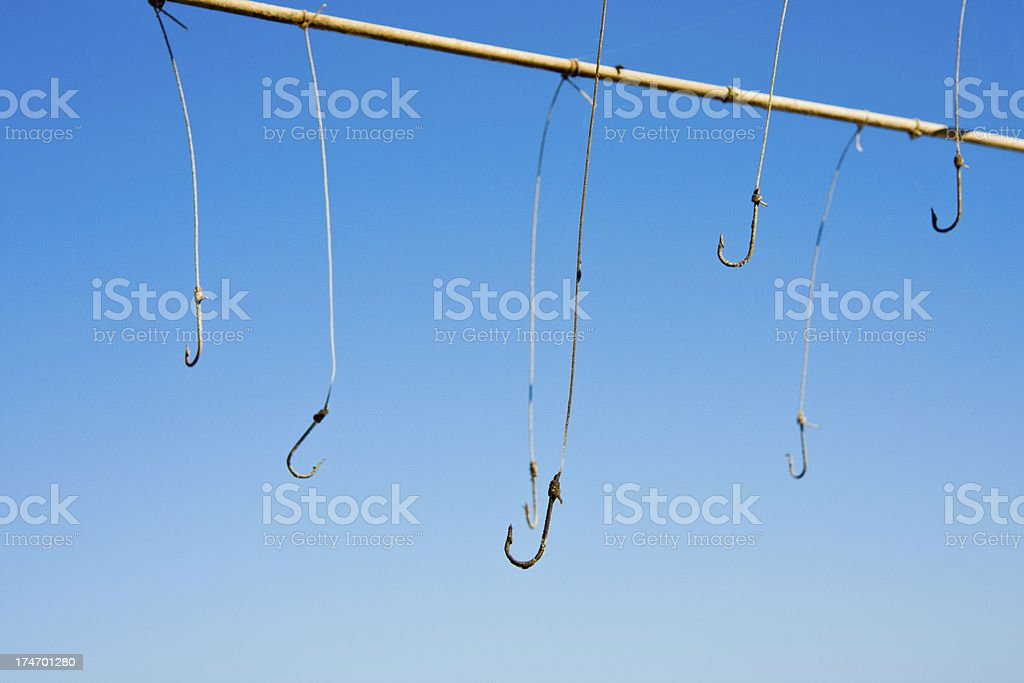 row of fishing hooks royalty-free stock photo