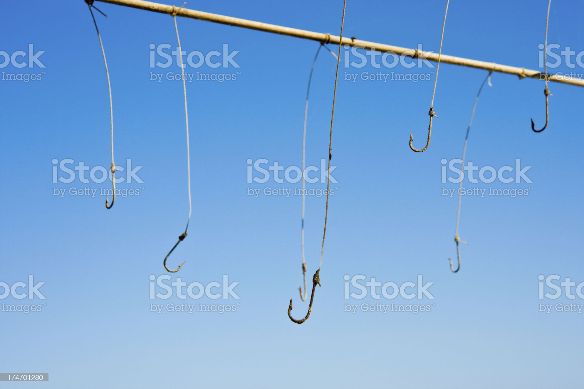 row of fishing hooks royalty-free stock photo