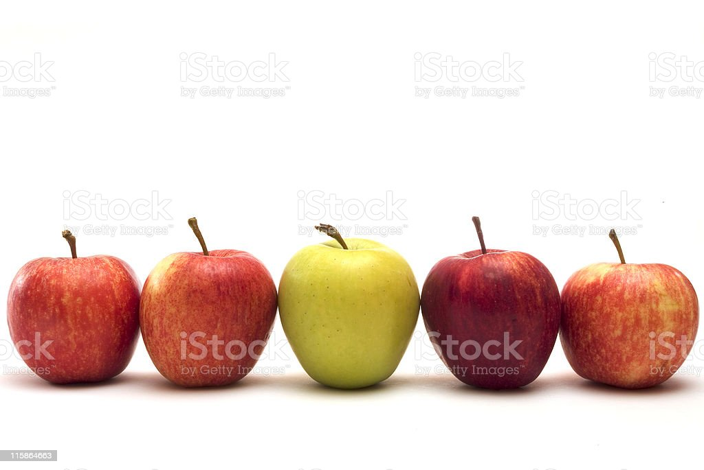 Row of five apples with different colors on a white surface royalty-free stock photo