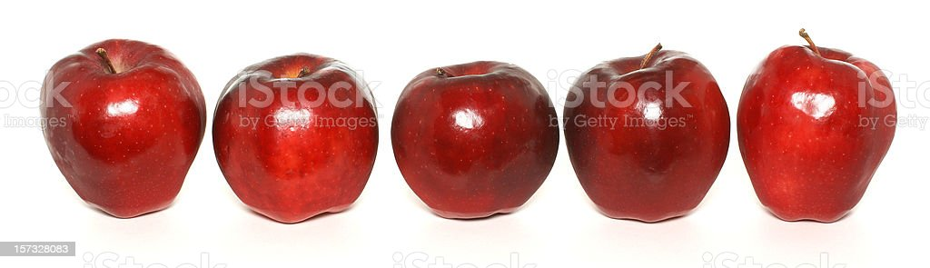 row of five red apples on white royalty-free stock photo