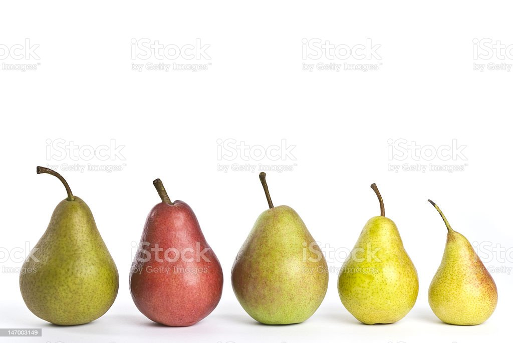 Row of five various colored pears on a white background stock photo