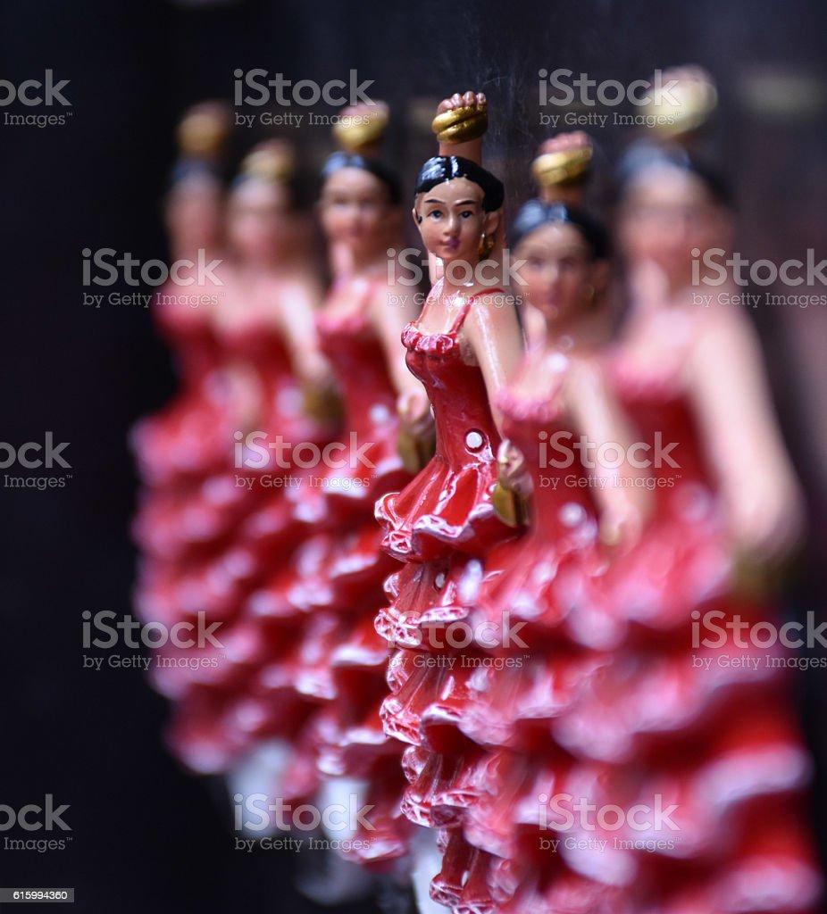 Row of flamenco dancer figurines stock photo