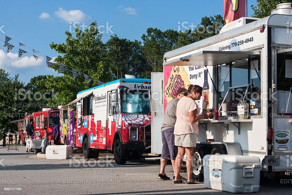 Row Of Food Trucks Serves Customers At Georgia Festival stock photo