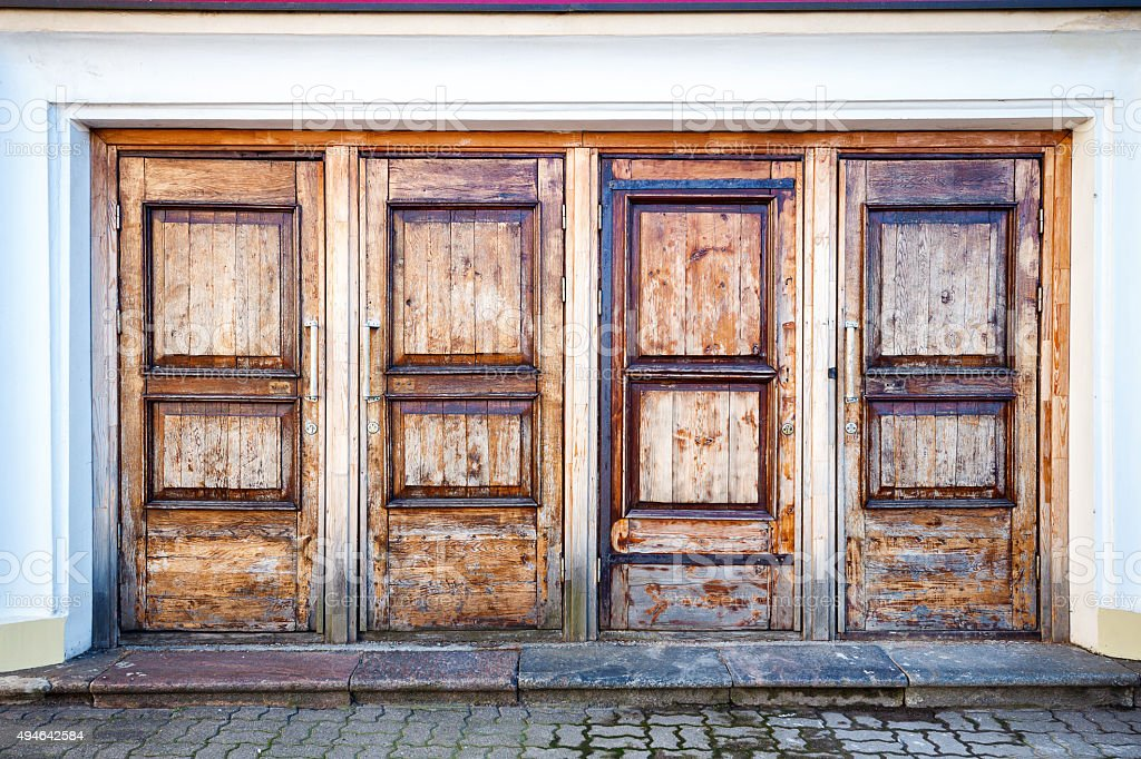 Row of four wooden doors stock photo