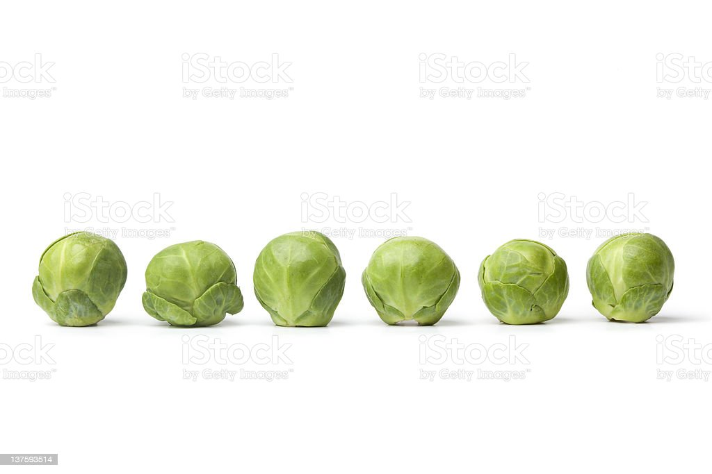 Row of fresh Brussel sprouts stock photo