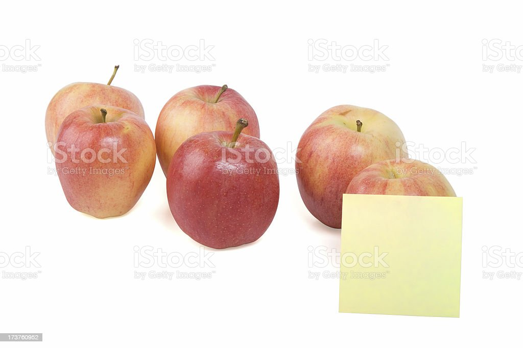 Row of Gala apples with note paper royalty-free stock photo