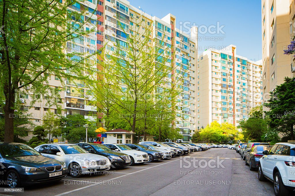 Row of Gangnam apartment buildings with luxury cars stock photo