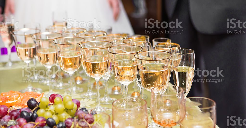 row of glasses filled with champagne are lined up ready stock photo