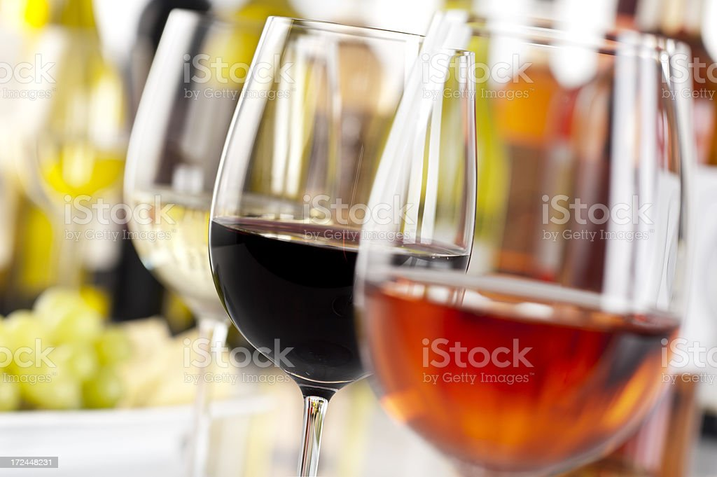Row of glasses with a different wine in each glass stock photo