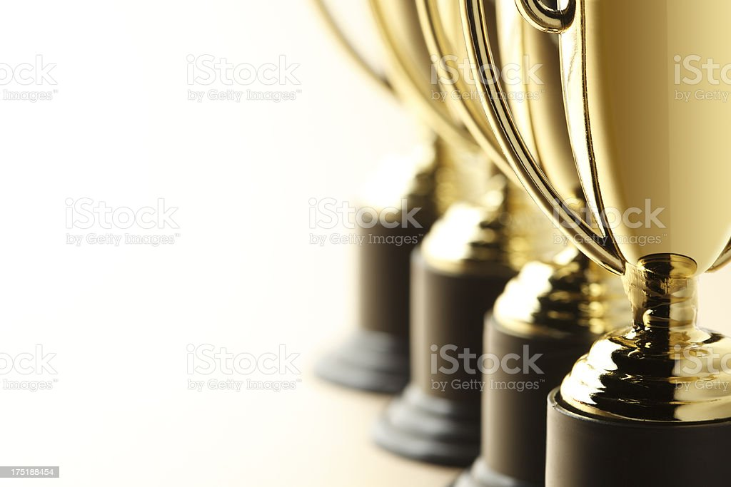 Row of gold trophies stock photo