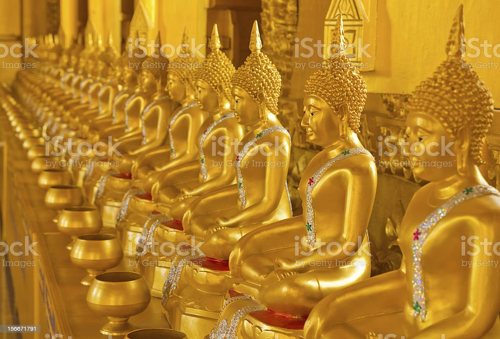 Row of golden buddha statue at Thailand Temple. royalty-free stock photo